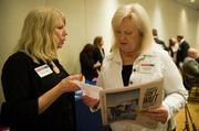 From left: Terry Breen of the Pittsburgh Business Times talks with Lynn DeLorenzo of TarquinCore.