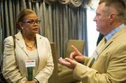 Gerri Jones of California University of PA talks with Craig Butzine also with California University of PA.