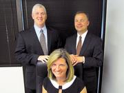 (Back left) Chris Mason, VP of The Perduco Group; (Front) Toyzanne Mason, co-founder and president; and (Back right) Stephen Chambal, VP and co-founder.