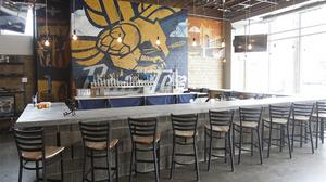 Craft brewery opening event space, expanding distribution