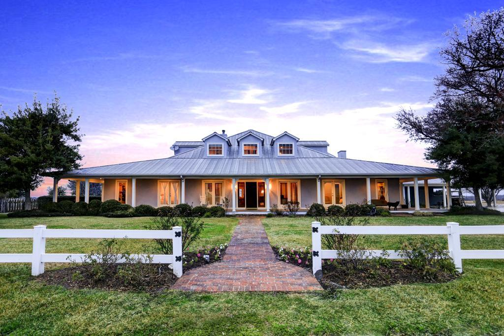 Classic ranch style home houston business journal for Texas ranch homes