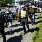 Protesters at Alaska Air annual meeting demand pay raise for baggage handlers