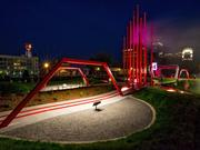 """Winston-Salem's latest attraction, with towering red """"smokestacks"""" that release clouds of water vapor and an """"artist performance shelter"""" sculpted from silvery steel bands, opened May 9."""