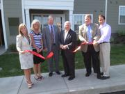 Developer Ralph Falbo cuts the ribbon at a grand opening ceremony Thursday for Gateway at Summerset. With him are, from left, Stephanie Fuchs of Pennrose Properties, Property Manager Melissa Kaczmarek, Murray Rust of Montgomery & Rust, James Keating and Dan Rothschild.