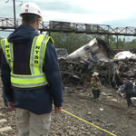 Amtrak derailment: Engineer's cell phone records show calls made; another passenger sues