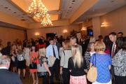 The crowd builds as the last guests arrive before the start of the awards ceremony.