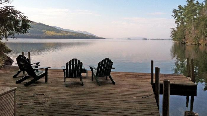 The view from the dock of a $8.5 million home for sale in Bolton Landing on Lake George, New York. The 4,000-square-foot-plus home sits on 8.2 acres with nearly 1,300 feet of shoreline, a covered cedar-shake boathouse with three slips and a seaplane ramp.