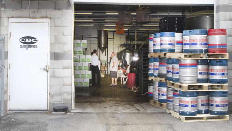 Kegs of beer outside Columbus Brewing.