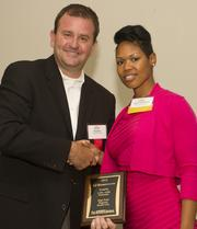 Steve Neu of presenting sponsor United Healthcare presents Latrice Bankhead of High Point Regional Health with the health system's award for being a finalist in the Triad's Healthiest Employers program.