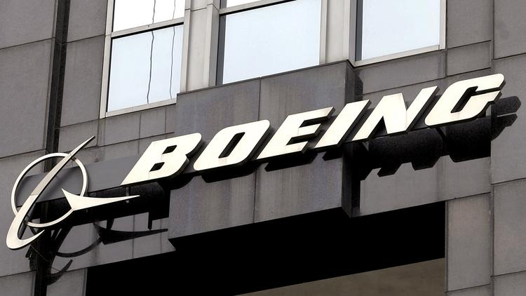Boeing signage is seen displayed on its building in Chicago. Photographer: Tim Boyle/Bloomberg News