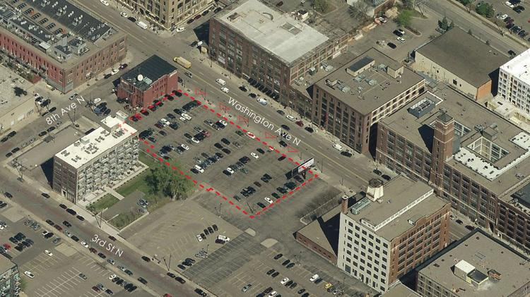 An aerial view of some of Greco's North Loop holdings. The 715 Second St. N is the shorter building in the top right. The area outlined in red is the parking lot split between Greco and United Properties.