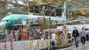 A Boeing 777 jetliner is under construction on the manufacturing floor in Everett, Washington,  June 1, 2015.