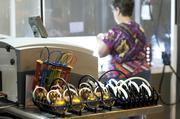 Sharon Davis prepared molds for lens coating systems.