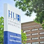 What prompted Howard University to monitor patient for Ebola