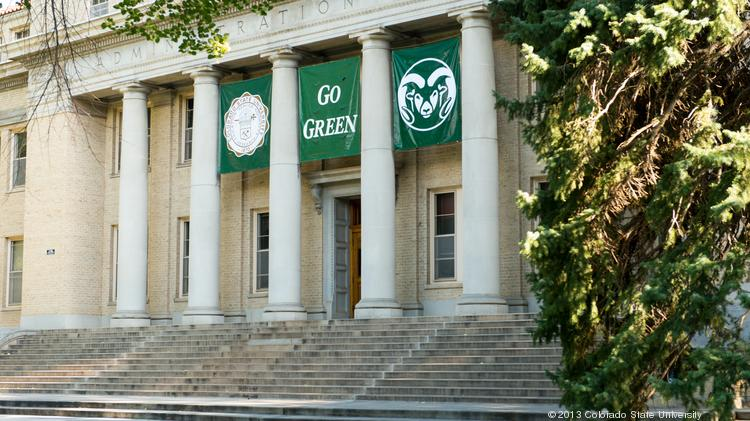 The Colorado State University Administration Building Has A Go Green Banner Hanging In Honor