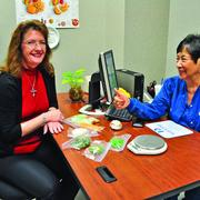 Gayla Watley, a Valero Energy crude scheduler, meets with Health By Design nurse Anita Taylor to talk about healthy snacks and portions.