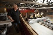 Guy Lamberg is starting the restaurant with his brother-in-law and is seen here overseeing the renovation of the space.  Click here to read storyBourbon, barn wood greet Prodigal guests: Table Talk