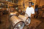 Back at MillerCoors, George Rave maneuvers beer barrels.  Click here to read storyTenth and Blake to increase production level