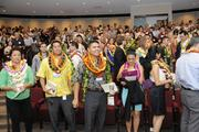Members of PBN's Forty Under 40 Class of 2013 exit the theater at the Hawaii Convention Center following the program.