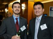 Tomas Petry of Gallagher Benefit Services and Kyle Chuang of Cambridge Mercantile Group during the Puget Sound Business CFO of the Year Awards at the Grand Hyatt in Seattle on Thursday.