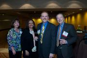 From left, Ann Gisler and Maria Harberg of Click Wholesale Distributing and Lance Herberg of Click Wholesale Distributing Inc. and Click Distributing East Inc. and Hal Beals of Wells Fargo during the Puget Sound Business CFO of the Year Awards at the Grand Hyatt in Seattle on Thursday.