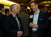 Howard Shalinsky, left, of the Puget Sound Business Journal and Josh Warborg of Robert Half International during the Puget Sound Business CFO of the Year Awards at the Grand Hyatt in Seattle on Thursday.