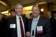Joe Brown, left, of Expense Reduction Analysis and David Schilling of Moss Adams LLP during the Puget Sound Business CFO of the Year Awards at the Grand Hyatt in Seattle on Thursday.