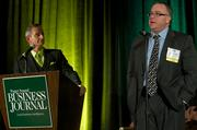Jonathan Tingstad of Seattle Cancer Care Alliance, right, and Puget Sound Business Journal Publisher Gordon Prouty during the Puget Sound Business CFO of the Year Awards at the Grand Hyatt in Seattle on Thursday.