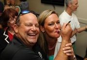 Joel Prescott, owner of Paradise Worldwide, and Bridgette Mill, publisher of the Tampa Bay Business Journal, feed each other a cupcake in the Bright House Networks suite at the TBBJ's Insiders Club event at Bright House Field during a Clearwater Threshers ball game. Tampa Bay executives know how to have fun. I love photographing a good time.