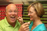 """Toffee to Go's Co-owners Jim and Lisa Schalk. Jim says, """"Our toffee is the best in the world and we have fun making it!"""" The fun shows in this photo. I see them at various locations like festivals and street markets in the Tampa Bay area and they are always smiling."""