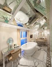 A sybaritic bathroom in the 5,000-square-foot Tata Presidential Suite at the Taj Mahal Palace hotel in Mumbai. The 15-room suite also includes three bedrooms, private study and business center. The price: $17,000 a night.