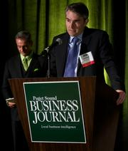 Duff Bryant, right, of Stoel Rives and Puget Sound Business Journal Publisher Gordon Prouty during the Puget Sound Business CFO of the Year Awards at the Grand Hyatt in Seattle on Thursday.