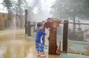And more water. Chris Serventi, 4, of Lakeland controls a fountain in the interactive area.