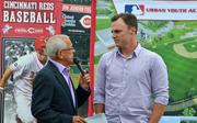 Reds announcer Marty Brennaman speaks with rightfifelder Jay Bruce.