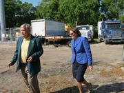 Carl Larson, president of Trucks-E-Quip, and Karen Mills, administrator of the U.S. Small Business Administration, tour the company's grounds in Tampa.