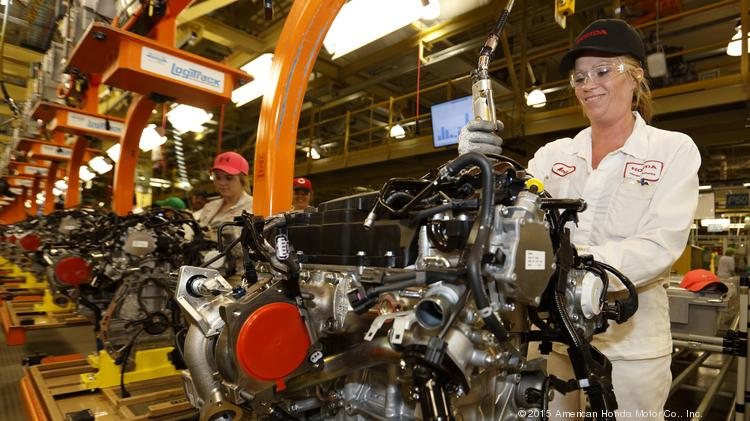 Honda Engine Plant Employee Amie Tierman Performs An Install Process On One Of The Plants New