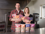 Brian and Andrea Strom inside their previous kitchen space for Crapola!