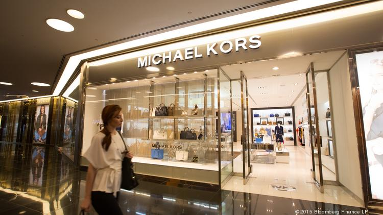 5b1500336866 Michael Kors Holdings Ltd. (NYSE  KORS) expects to close between 100 and