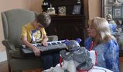 Kelly Fischer and her son Noah, who is blind and autistic, play in their living room in New Orleans in June 2011. Researchers at Children's Hospital Los Angeles have made new discoveries that may help them better understand, and treat, underlying causes of the more severe effects of autism.