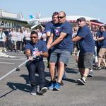 Russell Wilson easily thumps comedian Joel McHale in Alaska Airlines charity airplane pull