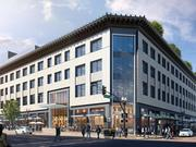 Rendering highlights the remodeled building with new windows and more open, inviting ground-floor retail space.