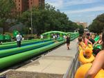 A giant water slide is returning to Cincinnati's streets this summer