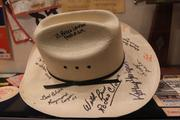 A cowboy hat with signatures from some rodeo participants.