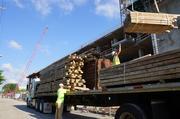 Contractors truck in lumber for the building.