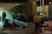 Crews work on a water system for the building's labs.