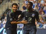 Seattle Sounders forward Eddie Johnson (right) and Steven Beitashour, then of the San Jose Earthquakes, celebrate the winning goal in the 2012 MLS All-Star Game.