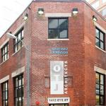 Consulting firm acquires rare Class A alley office building