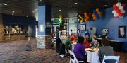 An area of the lower level concourse of the Greensboro Coliseum was upgraded to create the Ovations Lounge, a new VIP area with full-service bar, widescreen TVs, carpeting and seating.