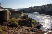 Water sprays from Willamette Falls beyond a treatment plant at the Blue Heron Paper site in Oregon City.