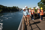 A group of Portland-area officials pauses to look at the Willamette River during a tour of the closed Blue Heron Paper mill site in Oregon City. A coalition is forming to redevelop the property and reclaim the falls (behind the photographer in this photo) for public viewing.
